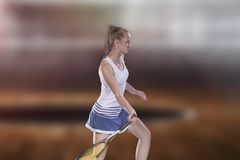 Female tennis player reaching to hit the tennis ball on court.  Stock Images