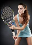 Female tennis player ready to hit Royalty Free Stock Photo