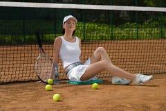 Female tennis player resting stock photos