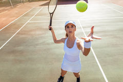 Female tennis player serving the ball Royalty Free Stock Images