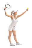 Female tennis player serving Royalty Free Stock Photos