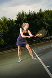 Female tennis player serving Stock Image