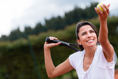 Female tennis player serving Stock Images