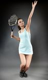 Female tennis player in the serving position Royalty Free Stock Images