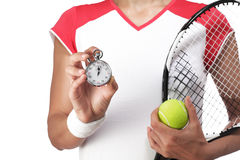 Female tennis player showing a stopwatch Stock Photos