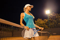 Female tennis player standing at court Stock Photo