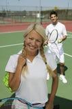 Female tennis player standing on tennis court portrait Stock Photo