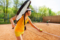 Female tennis player starting set on clay court Royalty Free Stock Image