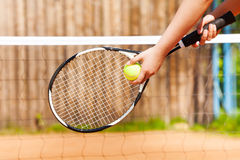 Female tennis player starting set outdoor Stock Photos