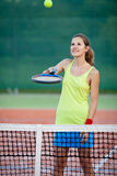 Female tennis player on the tennis court Stock Images