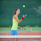 Female tennis player on the tennis court Royalty Free Stock Image