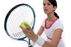 Tennis player about to serve Stock Photography