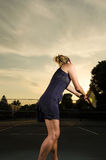 Female tennis player about to serve Royalty Free Stock Image