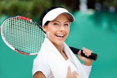 Female tennis player with towel on her shoulders Stock Image