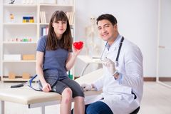 The female tennis player visiting male doctor for check-up. Female tennis player visiting male doctor for check-up stock photos