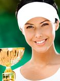 Female tennis player won the cup. Tennis player won the cup at the sport competition. Prize Stock Photos