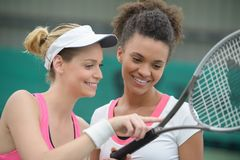Female tennis players having rest after game. Female tennis players having rest after the game Royalty Free Stock Photography