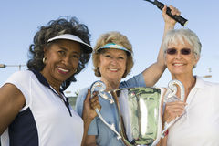 Female Tennis Players Holding Trophy Stock Photography