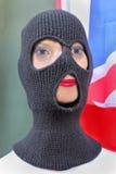 Female terrorist. With rib knit three hole balaclava royalty free stock photo