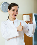 Female therapeutist recommending new dietary supplement Stock Photo