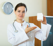 Female therapeutist recommending new dietary supplement Royalty Free Stock Images