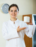 Female therapeutist recommending new dietary supplement Stock Photos
