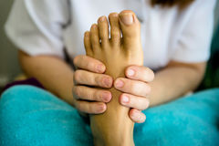 A female therapist massages a patient`s feet royalty free stock photos