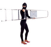 Female thief in balaclava keeping ladder Royalty Free Stock Images
