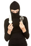 Female thief in balaclava with light bulbs Royalty Free Stock Photos