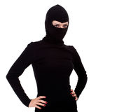 Female thief in black clothes and balaclava Stock Photo