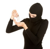 Female thief in black clothes and balaclava Stock Photos