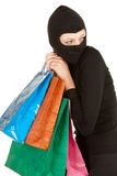 Female thief in black clothes and balaclava Royalty Free Stock Image