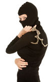 Female thief in black clothes and balaclava Royalty Free Stock Photo