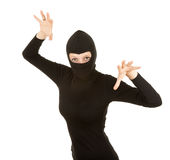 Female thief in black clothes and balaclava Stock Image