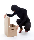 Female thief with box Royalty Free Stock Image