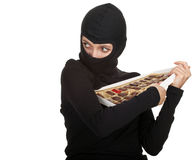 Female thief with box of chocolates Royalty Free Stock Photography