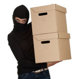 Female thief with boxes Stock Images