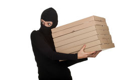 Female thief with boxes of pizza Stock Photo