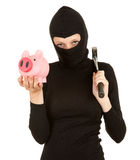 Female thief with hammer and piggy bank Royalty Free Stock Photo