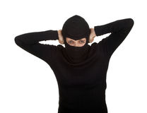 Female thief with hands on ears Royalty Free Stock Image