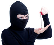Female thief keeping bracelet Stock Photography