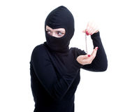 Female thief keeping bracelet Royalty Free Stock Image