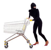Female thief with shopping cart Royalty Free Stock Photos