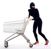 Female thief with shopping cart Royalty Free Stock Image