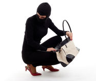 Female thief with stolen bag Royalty Free Stock Image