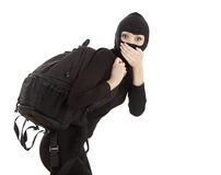 Female thief with stolen rucksack. Female thief in black balaclava with stolen rucksack Royalty Free Stock Photography