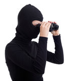 Female thief  using binoculars Stock Image