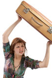 Female throwing a suitcase Stock Image
