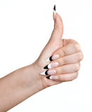 Female thumb up. Woman hand with thumb up and long nails, on white background stock photography