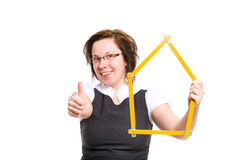 Female with thumb up and house shape measure Royalty Free Stock Photo